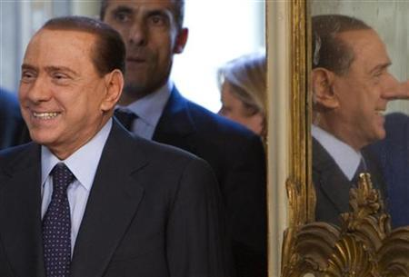 Italian Prime Minister Silvio Berlusconi is reflected in a mirror as he arrives for a private meeting with his Lebanese counterpart Saad Hariri (unseen) at Chigi palace in Rome, April 20, 2010. REUTERS/Max Rossi