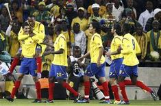 <p>Colombia's Giovanni Moreno (L) is congratulated by his teammates after scoring a goal against South Africa during their international friendly soccer match at Soccer City stadium in Johannesburg, May 27, 2010. REUTERS/Siphiwe Sibeko</p>