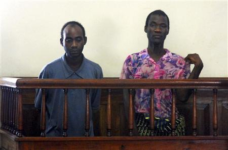 Gay couple Steven Monjeza (L) and Tiwonge Chimbalanga appear before a magistrate court in Blantyre in this January 4, 2010 file photo. REUTERS/Eldson Chagara/Files