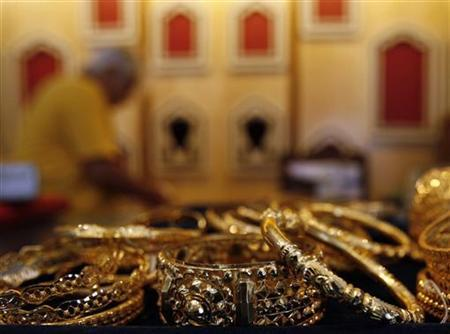 A gold jewellery shop owner arranges ornaments at a counter in Kolkata May 27, 2010. REUTERS/Parth Sanyal
