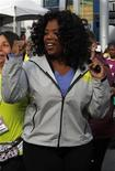 "<p>Oprah Winfrey gestures as she starts her charity walk called ""Live Your Best Life Walk"" in New York in this May 9, 2010 file photo. REUTERS/Jessica Rinaldi</p>"
