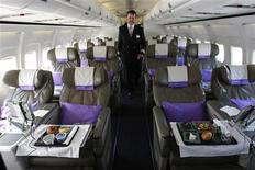 <p>OpenSkies Airline Senior Flight Officer Andy Pomeroy walks down the aisle of one of its Boeing 757-200 jets that features 84 business class seats only cabins in Dulles, Virginia, March 24, 2010. REUTERS/Hyungwon Kang</p>