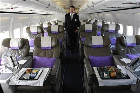 OpenSkies Airline Senior Flight Officer Andy Pomeroy walks down the aisle of one of its Boeing 757-200 jets that features 84 business class seats only cabins in Dulles, Virginia, March 24, 2010. REUTERS/Hyungwon Kang
