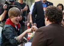 <p>Justin Bieber (L) bumps fists with actor Jonah Hill during an appearance on NBC's 'Today' show in New York, June 4, 2010. REUTERS/Brendan McDermid</p>