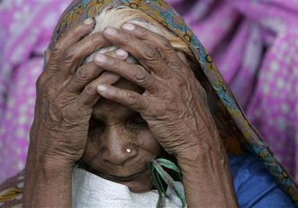 A victim of Bhopal gas tragedy attends a demonstration outside a court in the central Indian city of Bhopal June 7, 2010. REUTERS/Raj Patidar