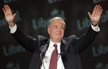 Former Canadian Finance Minister Paul Martin takes the stage during a tribute in his honour at the Liberal convention in Montreal, November 30, 2006. REUTERS/Shaun Best