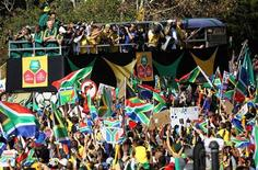 "<p>South Africa's national soccer team ""Bafana Bafana"" celebrate on the streets of Sandton during a parade in Johannesburg June 9, 2010. REUTERS/Siphiwe Sibeko</p>"