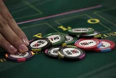 <p>Casino chips are displayed during the Global Gaming Expo Asia in Macau June 9, 2010.REUTERS/Tyrone Siu</p>