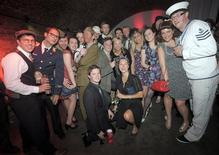 <p>Guests pose for a photograph at Blitz Party in east London, June 6, 2009. REUTERS/Nick Cunard/Handout</p>