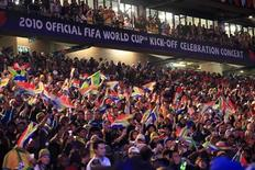 <p>Fans attend the opening concert for the 2010 World Cup at the Orlando Stadium in Soweto, Johannesburg June 10, 2010. REUTERS/Radu Sigheti</p>