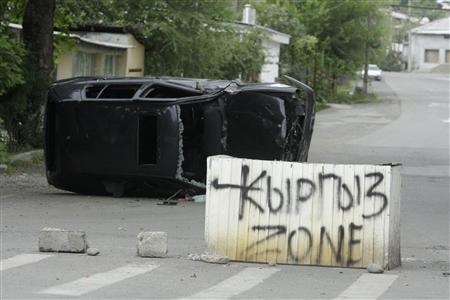 A concrete block with a sign 'Kyrgyz Zone' stands in the middle of the street in the city of Osh, June 13, 2010. REUTERS/Stringer