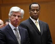 <p>Dr. Conrad Murray (R) stands next to his attorney J. Michael Flanagan during his hearing at a Criminal Court in Los Angeles April 5, 2010. Murray is charged with involuntary manslaughter in pop singer Michael Jackson's June 2009 death. REUTERS/David McNew/Pool</p>