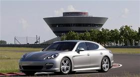 <p>A Panamera car is pictured on a testing track at the Porsche plant in Leipzig, June 2, 2009. REUTERS/Tobias Schwarz</p>