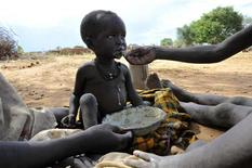 <p>A malnourished child is fed a meal in Uganda's Karamoja region, 700km (420 miles) northeast of Capital Kampala, were over one million people face starvation due to prolonged drought, May 19, 2008. REUTER/James Akena</p>