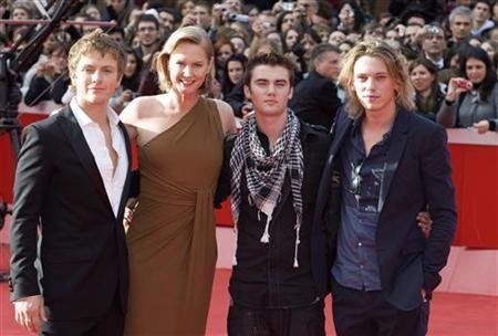 Screenwriter Melissa Rosenberg (2nd L) accompanies actors Charlie Bewley (L), Cameron Bright and Jamie Campbell Bower (R) on the red carpet before a preview of clips from ''The Twilight Saga: New Moon'' at the Rome film festival October 22, 2009. REUTERS/Chris Helgren