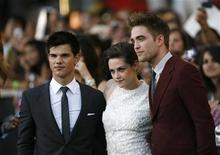"<p>Cast members Taylor Lautner (L), Kristen Stewart and Robert Pattinson (R) pose at the premiere of ""The Twilight Saga: Eclipse"" during the Los Angeles Film Festival at Nokia theatre at L.A. Live in Los Angeles June 24, 2010. REUTERS/Mario Anzuoni</p>"