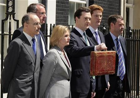 Chancellor George Osborne (C) holds up the dispatch box with members of his team on the steps of 11 Downing Street in London, June 22, 2010. REUTERS/Paul Hackett