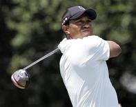 <p>Tiger Woods watches his shot off the third tee during the first round of the AT&T National golf tournament at the Aronimink Golf Club in Newtown Square, Pennsylvania July 1, 2010. REUTERS/Tim Mihalek</p>