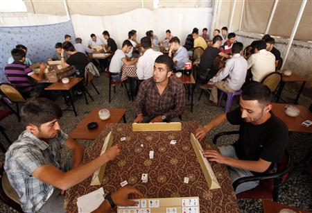 Men play a game in a tea house in the southeastern Turkish city of Hakkari, June 28, 2010. REUTERS/Umit Bektas