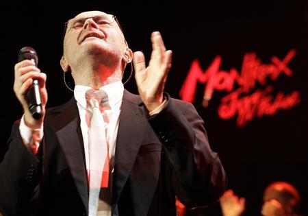 British singer Phil Collins performs during ''Up Close & Personal: Phil Collins Plays '60s Motown and Soul'' during the 44th Montreux Jazz Festival in Montreux July 1, 2010. The show will feature his interpretations of the biggest R&B, soul and pop hits of the '60s. REUTERS/Denis Balibouse