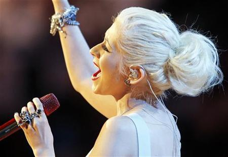 Singer Christina Aguilera performs the national anthem before the Los Angeles Lakers play the Boston Celtics in Game 7 of the 2010 NBA Finals basketball series in Los Angeles, California, June 17, 2010. REUTERS/Mike Blake