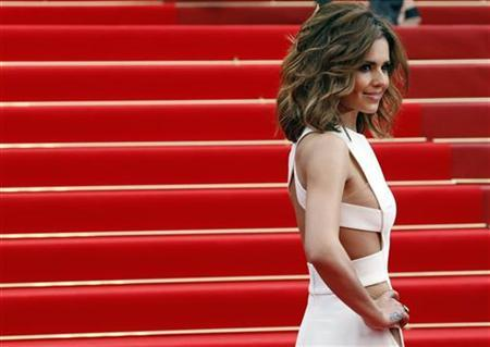 Singer Cheryl Cole arrives on the red carpet for the screening of ''Hors La Loi'' (Outside the Law) in competition at the 63rd Cannes Film Festival May 21, 2010. REUTERS/Jean-Paul Pelissier