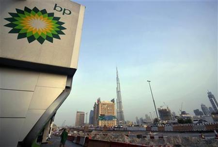 The British Petroleum logo is seen near a petrol station in Dubai with the Burj Khalifa tower in the background July 7, 2010. REUTERS/Jumana ElHeloueh