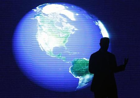 A silhouette shot of Al Gore, a U.S. former vice-president and Nobel Peace Prize Laureate, is seen in front of a monitor during his lecture on climate change inside a mall in Manila June 8, 2010. REUTERS/Romeo Ranoco
