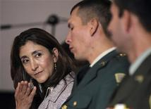 "<p>Former FARC hostage, French-Colombian Ingrid Betancourt (L), gestures during a news conference amid a ceremony for the two-year anniversary of ""Operation Jaque"", a Colombian military operation that freed 15 hostages including Betancourt, at a military school in Bogota July 2, 2010. REUTERS/John Vizcaino</p>"