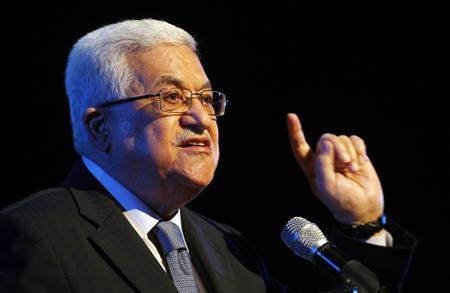 Palestinian President Mahmoud Abbas speaks during a a religious event to mark the Prophet Muhammad's ascension to heaven in the West Bank city of Ramallah July 10, 2010. REUTERS/Mohamad Torokman