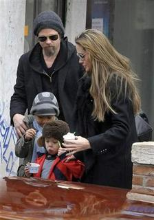 U.S. actors Brad Pitt and Angelina Jolie walk aboard a taxi boat with their son Maddox Chivan Jolie-Pitt and daughter Shiloh Nouvel Jolie-Pitt (in red coat) in Venice February 16, 2010. REUTERS/Michele Crosera