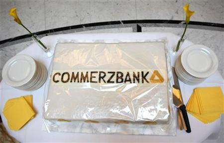 A cake decorated with the new Commerzbank logo stands on a table at a Commerzbank branch in Frankfurt June 15, 2010. Commerzbank launched their new logo on Tuesday. REUTERS/Ralph Orlowski