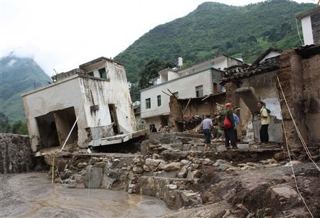 A view of damaged houses after flash floods hit Xiaohe township of Qiaojia County, southwest China's Yunnan province July 13, 2010 in this photo released by China's official Xinhua News Agency. REUTERS/Xinhua