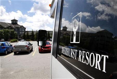 The Deerhurst Resort, which will be hosting the G8 Summit, is reflected in a bus window in Huntsville June 1, 2010. REUTERS/ Mike Cassese