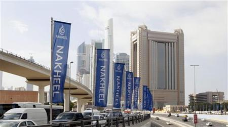 Flags for property company Nakheel are seen on the Sheik Zayed highway in Dubai December 14, 2009. REUTERS/Mosab Omar