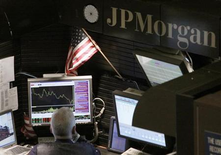 A trader works in the J.P. Morgan stall on floor of the New York Stock Exchange in this September 14, 2009 file photo. REUTERS/Brendan McDermid