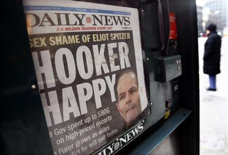 A copy of the New York Daily News is seen in a news stand outside the offices of New York Governor Eliot Spitzer in Manhattan March 12, 2008. REUTERS/Mike Segar