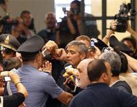 <p>Hollywood actor George Clooney (C) is surrounded by a crowd as he leaves the court in Milan July 16, 2010. Clooney testified on Friday at a trial of three people accused of exploiting his name to promote a fashion brand in Milan. REUTERS/Alessandro Garofalo</p>