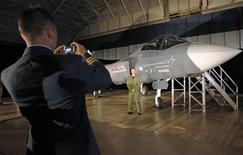 <p>A member of the Canadian Forces has his picture taken beside a F-35 Joint Strike Fighter before the start of a news conference in Ottawa July 16, 2010. Canada will buy 65 new fighter jets from Lockheed Martin Corp for C$9 billion ($8.6 billion), one of the biggest arms deals in the nation's history, Defence Minister Peter MacKay said on Friday. REUTERS/Chris Wattie</p>