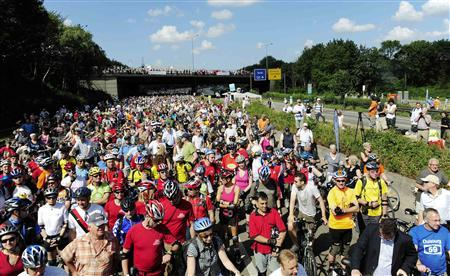 Thousands of bicyclists wait in Duisburg to ride on the 60 km (38 miles) long A40/B1 motorway between the western German cities of Dortmund and Duisburg, which has been turned into the ''Still-Leben A40/B1'' (Still-Life A40/B1) as part of an event for the European Capital of Culture RUHR 2010, July 18, 2010. REUTERS/Thomas Berns