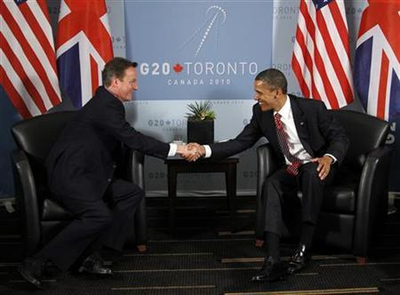U.S. President Barack Obama (R) and British Prime Minister David Cameron shake hands at the end of their bilateral meeting at the G20 Summit in Toronto June 26, 2010. REUTERS/Jason Reed