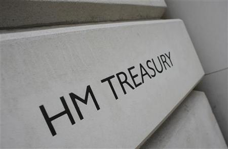 A general view shows the sign outside the Treasury building in London March 24, 2010.