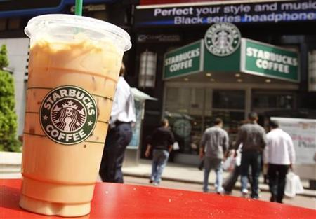 A Starbucks drink is seen on a table in New York's Times Square April 21, 2010. REUTERS/Shannon Stapleton