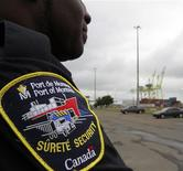<p>Security looks on at the Port of Montreal after about 850 longshoremen were locked out Monday morning by the Maritime Employers Association, closing Canada's second largest port in Montreal, July 19, 2010. REUTERS/Christinne Muschi</p>