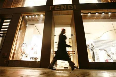 A passerby walks past the Fendi store in New York, February 15, 2007. REUTERS/Keith Bedford