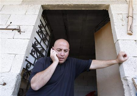 Sabbar Kashur speaks on a mobile phone at his mother-in-law's home in the Arab neighbourhood of Beit Safafa in Jerusalem July 22, 2010. Kashur, an Arab man who had consensual sex with a Jewish woman in Israel, has been convicted of rape in a ''sex through fraud'' case and sentenced to 18 months in jail. REUTERS/Ammar Awad