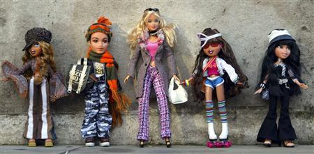 Bratz dolls and a Barbie Doll (C) are seen at the Dream Toys 2004 exhibition, which previews the year's top 10 toys and offers predictions from the Toy Retailers Association of the most popular toys for Christmas, in London, in this October 6, 2004 file photo. REUTERS/Stephen Hird/Files