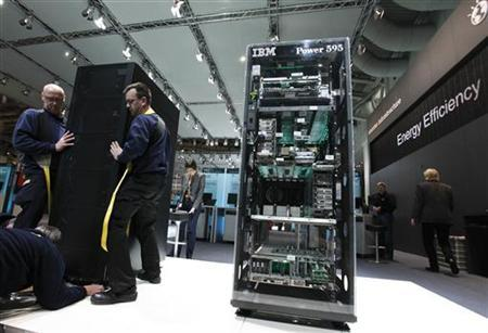 Workers move a server at the stand of U.S. IT firm IBM t the CeBIT exhibition centre in Hannover February 28, 2010. REUTERS/Thomas Peter