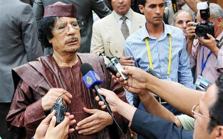 Libyan leader Muammar Gaddafi addresses the media as he leaves the venue of the African Union (AU) Summit in Uganda's capital Kampala July 27, 2010. REUTERS/Xavier Toya