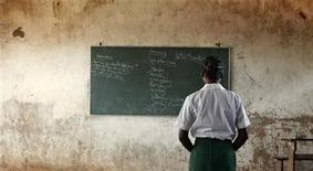 <p>A young girl reads the day's lessons at a school near Xia Xia, Mozambique on April 26, 2005. REUTERS/Photosensitive/Andy Clark</p>